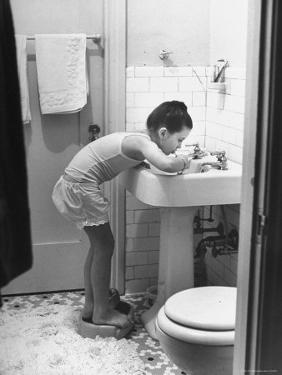 Child Star Margaret O'Brien Brushing Her Teeth by Bob Landry