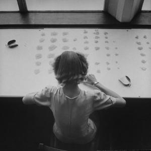 Newly Trained Girl Sorting Thousands of Dollars Worth of Diamonds by Bob Landry