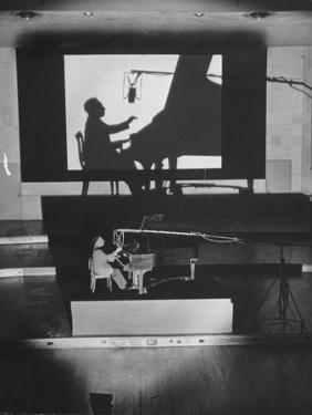 """Pianist Artur Rubinstein Playing Piano for """"Concerto"""" by Bob Landry"""