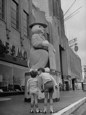 The Toll Brothers Admiring 6 Ft. Easter Bunny by Bob Landry