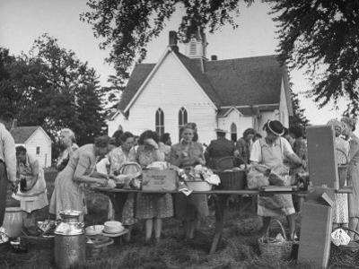 Women Preparing for the Church Picnic by Bob Landry