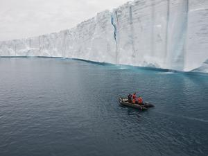 People in an Inflatable Boat Exploring an Ice Shelf by Bob Smith