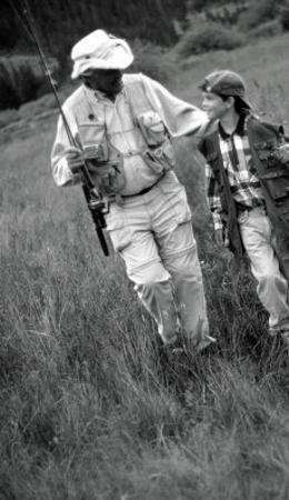 Grandfather and Boy in Field with Fishing Poles, CO