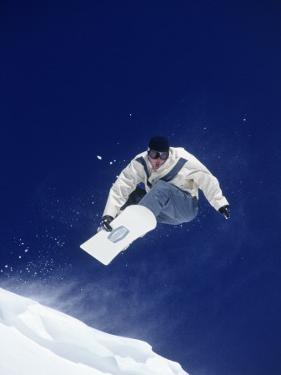 Man Snow Boarding, CO by Bob Winsett