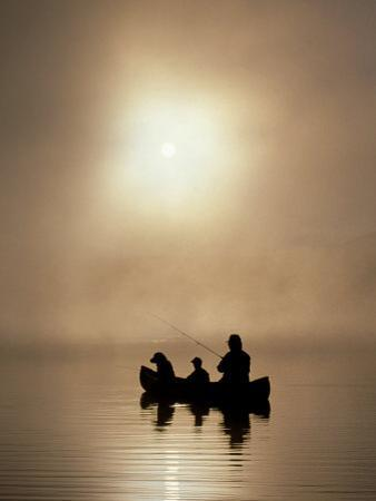 Silhouette of Father and Son Fishing