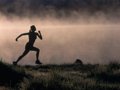 Silhouette of Woman Trail Running, CO