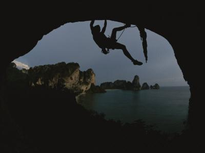 A Climber Negotiates an Overhang on the South Coast of Thailand