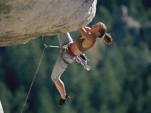 A Female Climber Negotiates an Overhang by Bobby Model