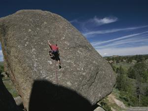 A Man Climbs a Route Called Stand and Deliver by Bobby Model