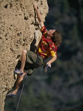 A Man Climbs Sheep Reaction in Ten Sleep Canyon by Bobby Model