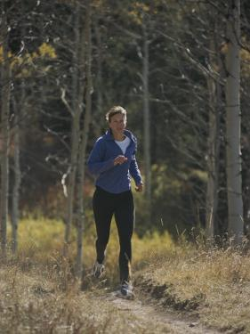 A Runner Takes an Autumn Jog Along Cache Creek by Bobby Model