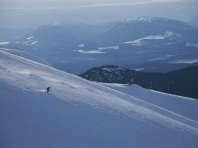 A Skier Explores a Vast Expanse of Untracked Powder