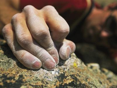 Close View of a Rock Climbers Dusted Hands Crimping Rock