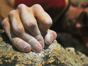 Close View of a Rock Climbers Dusted Hands Crimping Rock by Bobby Model