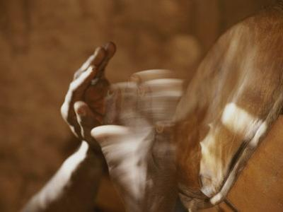 Dogon Hands, Blurred by the Quick Movement of Playing the Drums