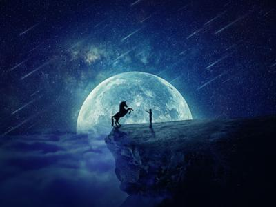 Night Scene with Boy Standing at Edge of Cliff Chasm Trying to Tame Wild Unicorn
