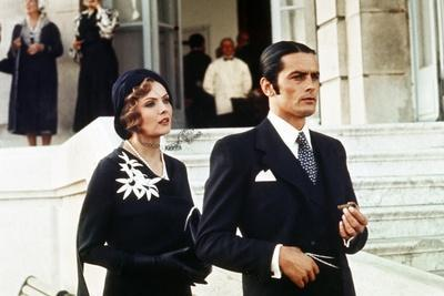 https://imgc.allpostersimages.com/img/posters/borsalino-by-jacques-deray-with-corinne-marchand-and-alain-delon-1970-photo_u-L-Q1C40VW0.jpg?artPerspective=n