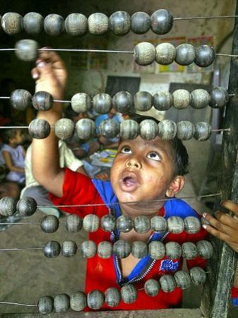 Boy, 3, Counts on an Abacus at a School in Allahabad