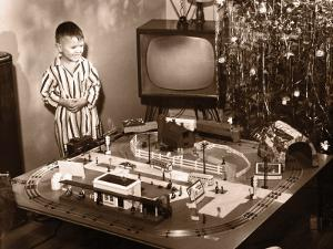 Boy (6-8) Looking at Model Train Set on Christmas Day