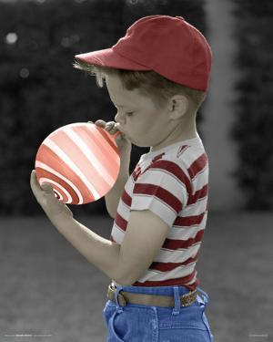 Boy Blowing Up Balloon
