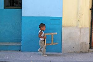 Boy Carrying Stool, Havana, Cuba