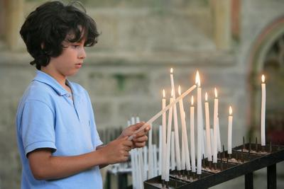 https://imgc.allpostersimages.com/img/posters/boy-lighting-a-church-candle_u-L-Q1GYHXF0.jpg?artPerspective=n