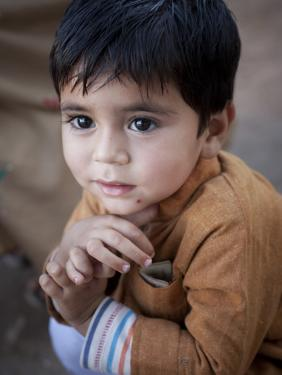 Boy Waits to Receive a Ration of Donated Rice at Food Distribution Center in Islamabad, Pakistan
