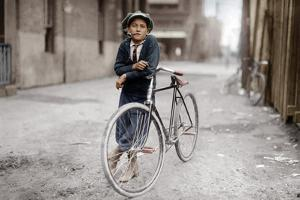 Boy with Bicycle, Smoking a Pipe