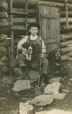Boy with Rifle and Two Dogs