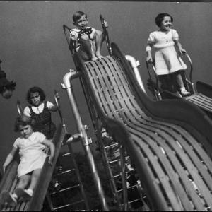 Boys and Girls Play on the Slides at a Playground