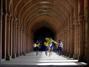 Boys Play Soccer Through an Arched Hallway at the Allahabad University Campus