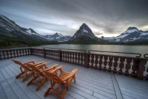 Glacier, Montana: Chairs Line the Deck of the Many Glacier Lodge During Sunset by Brad Beck