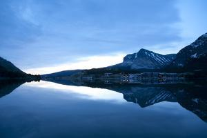 Glacier, Montana: Many Glacier Lodge Reflects Off of Swifcurrent Lake During Sunrise by Brad Beck