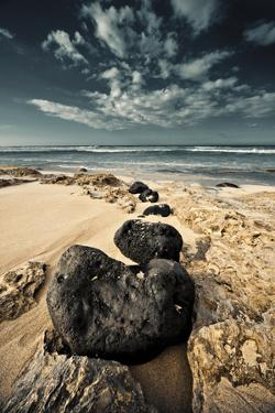 Kaena Point State Park, Oahu: a Trail of Black Lava Rocks Make their Way into the Incoming Tide by Brad Beck