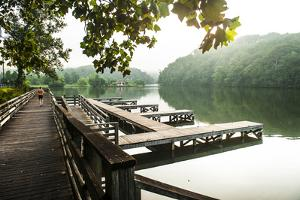 Lake Lure, North Carolina: a Man Goes for a Run Along the Shoreline of Lake Lure by Brad Beck