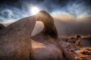 Lone Pine, California: a Woman Stands in Mobius Arch During Sunset by Brad Beck