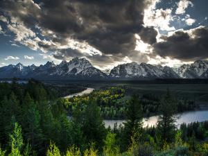 The Snake River with the Sun Setting over the Grand Tetons in the Background by Brad Beck
