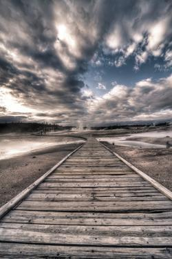 Yellowstone, Wyoming: a Wooden Path Going Through Norris Geyser Basin on a Cloudy Sunset by Brad Beck
