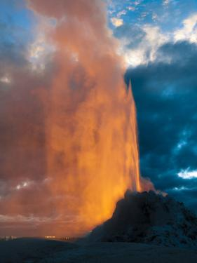 Yelowstone, Wy: White Dome Geyser Erupting with the Sun Setting Behind It by Brad Beck