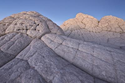 https://imgc.allpostersimages.com/img/posters/brain-rock-at-dusk-white-pocket-vermilion-cliffs-national-monument_u-L-PWFDGI0.jpg?p=0