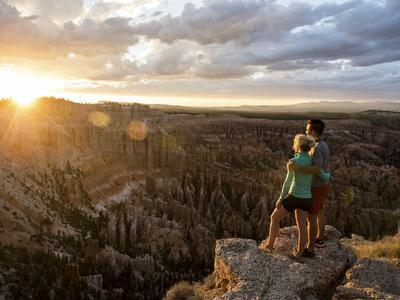 A Couple at Sunset in Bryce Canyon National Park in the Summer Overlooking the Canyon