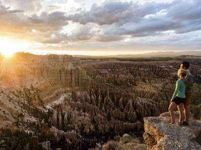 A Couple at Sunset in Bryce Canyon National Park, Utah, in the Summer Overlooking the Canyon