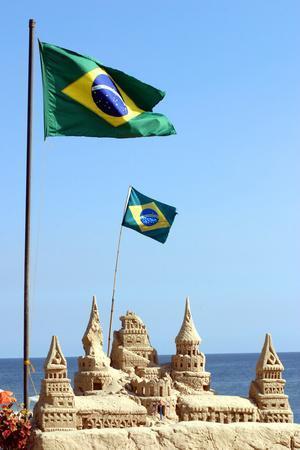 https://imgc.allpostersimages.com/img/posters/brazilian-flag-on-copacabana-beach-in-rio-de-janeiro_u-L-Q103BAC0.jpg?artPerspective=n
