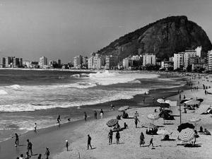 Brazilian Residents Relaxing at the Copacabana Beach