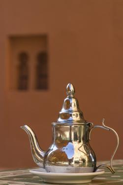 Africa, Morocco, Dades Gorge. Tea Service Reflects the Colors of Steep Walls by Brenda Tharp