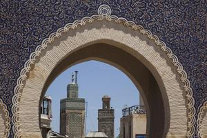 Africa, Morocco, Fes. an Arch with Classic Moorish Decor Frames Two Minarets by Brenda Tharp
