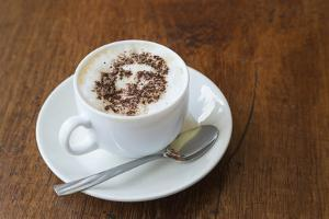 Cuba. Che Guevara in cinnamon atop a cup of cappuccino. by Brenda Tharp