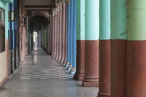 Cuba, Havana. Repeating Columns of an Arcade Along the Paseo Del Prado by Brenda Tharp