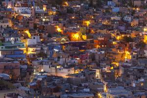Mexico, Guanajuato. Street lights add ambience to this twilight village scene. by Brenda Tharp