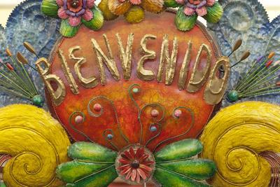 Mexico, San Miguel De Allende. a Colorful Metal Sign Saying 'Welcome' Is Sold in a Market